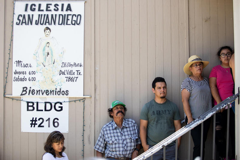 Residents line up outside the San Juan Diego Catholic Church in the Stony Point neighborhood of Del Valle during a press conference Monday to speak out against a traffic sting that they say targeted immigrants.