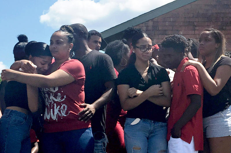 Devonte Ortiz's girlfriend, Amber Garcia (left), is comforted by his mother, Kristina Ortiz, after the family held a news conference Friday. Devonte Ortiz was shot and killed early Wednesday.