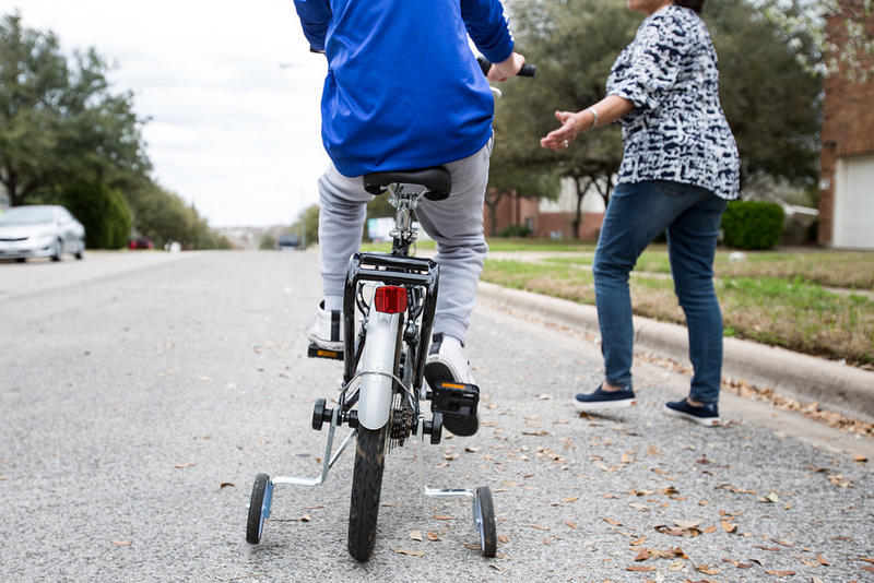 Eduardo Labastida learns how to ride a bike after school in his neighborhood in Round Rock. Eduardo has mitochondrial disease, which can cause developmental delays and muscle weakness.