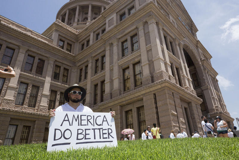 Ty Simsak joins thousands of protesters at the Texas Capitol last month for a rally against immigration policies affecting asylum seekers at the Mexico border.
