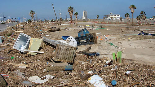 Wreckage litters the curb along Seawall Drive on Galveston Island after Hurricane Ike in 2008.
