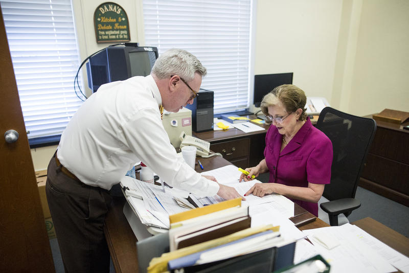 Travis County Clerk Dana DeBeauvoir works with Deputy Chief Ronald Morgan at the Travis County Courthouse in downtown Austin last week.