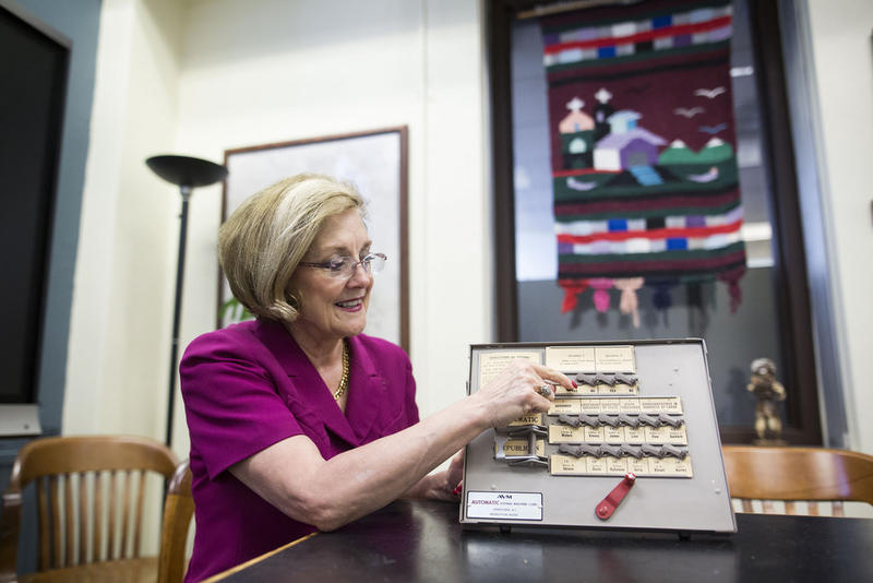 Travis County Clerk Dana DeBeauvoir demonstrates how to vote using an analog voting machine in the Travis County Courthouse in downtown Austin.