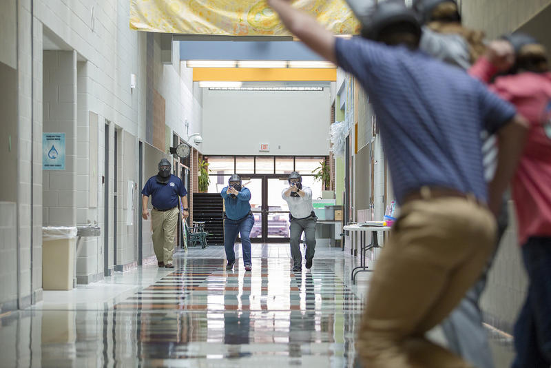 School marshal trainees go through a simulation of an active shooting at an elementary school in Pflugerville last week.