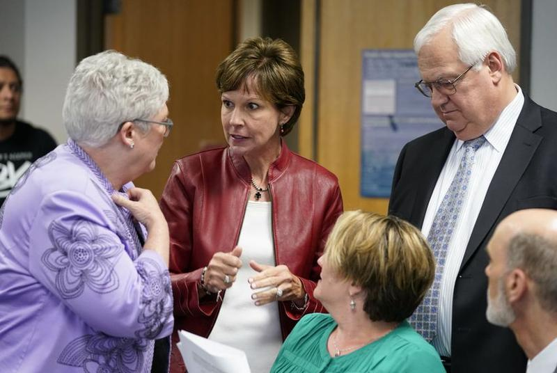 State Board of Education member Barbara Cargill speaks with spectators during a break in the State Board of Education meeting on proposed changes to the seventh-grade social studies curriculum on Tuesday.