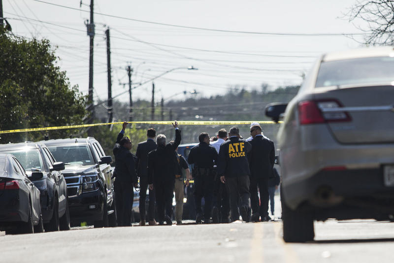 Emergency personnel work the scene of an explosion in Austin's Montopolis neighborhood during a series of bombings in March.