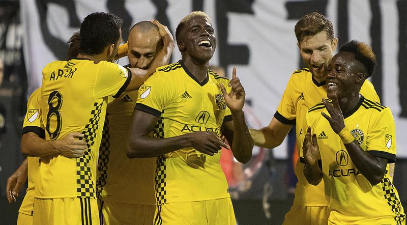 Gyasi Zardes celebrates with his Columbus Crew teammates after scoring against the Houston Dynamo on Aug. 11.