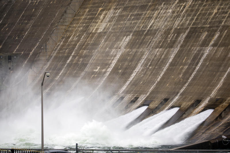 Water pours through the floodgates at Mansfield Dam along Lake Travis on Wednesday.