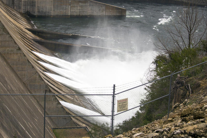 Water flows through open floodgates at the Mansfield Dam into Lake Travis last week. Water from the lake is sucked up through intake pipes and travels to plants for treatment.