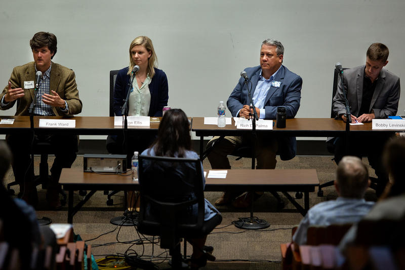 Frank Ward (far left) and Paige Ellis (second from left) participate in a District 8 candidate forum last month. The two will compete in a runoff Dec. 11.