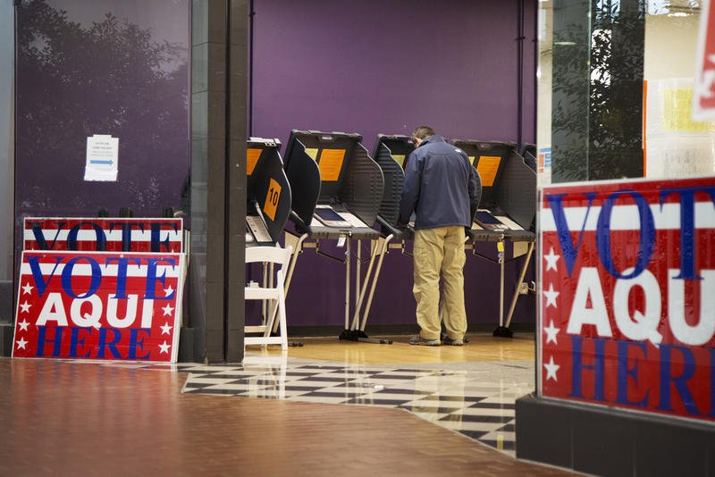 A voter casts his ballot on the first day of early voting in Texas last month.