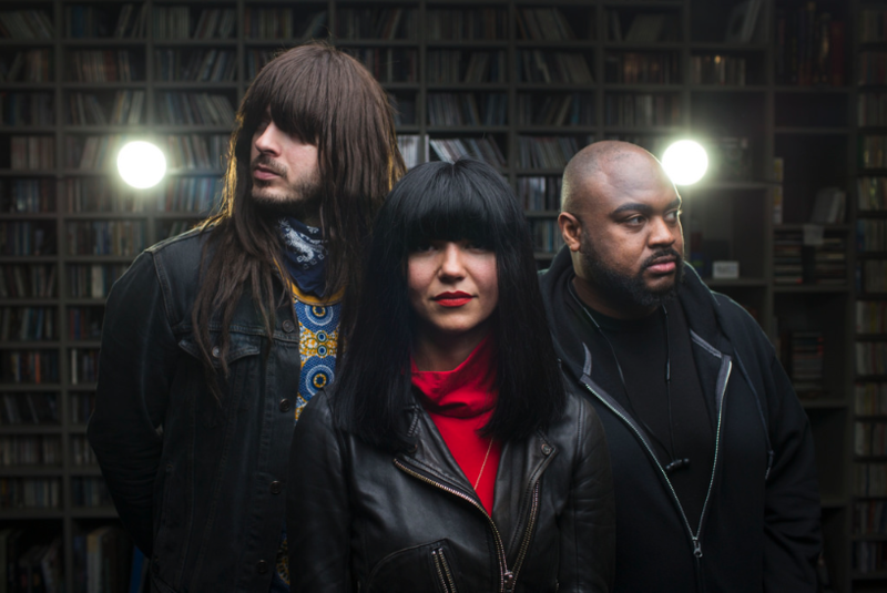 Members of Khruangbin pose for a photo after performing in KUTX's studio in March.