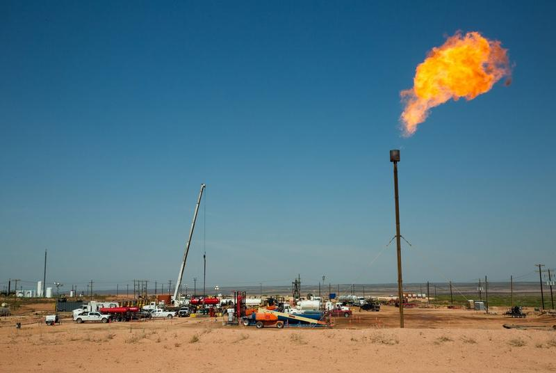 A flare burns atop a drill pad on land near Carlsbad, N.M. The oil rich Permian Basin straddles southeaster New Mexico and West Texas.