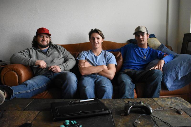 Tyler Kraatz, drummer, Derek Kapavik, guitarist, and Blake Hermes, lead singer, relax before a Mama Tried Band show