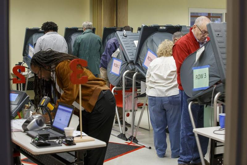 Texans cast their votes at the start of early voting at the Metropolitan Multi-Service Center near downtown Houston on Oct. 22.
