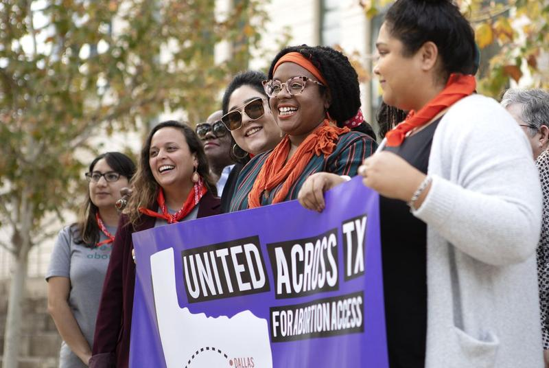 Abortion rights advocates pose for a photo outside the U.S. District Court in Austin.  The court is weighing whether abortion funds and health care providers can challenge restrictions to abortion access.