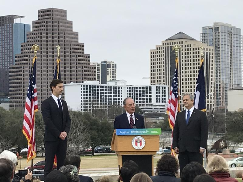 Flanked by City Manager Spencer Cronk and Mayor Steve Adler, former New York City Mayor Michael Bloomberg announces that Austin has won funding from his philanthropic organization to fight climate change.