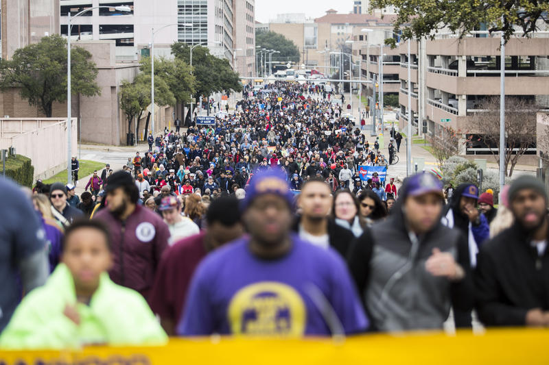 Hundreds of marchers walk from the UT Austin campus to Huston-Tillotson University during the annual Martin Luther King Jr. Day celebration.