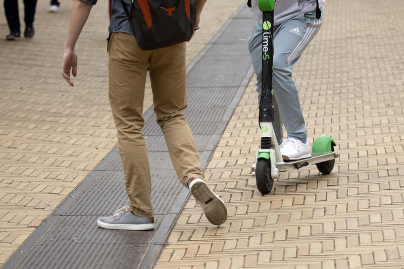 A near-miss between a scooter rider and a pedestrian along Speedway on the UT Austin campus Tuesday.