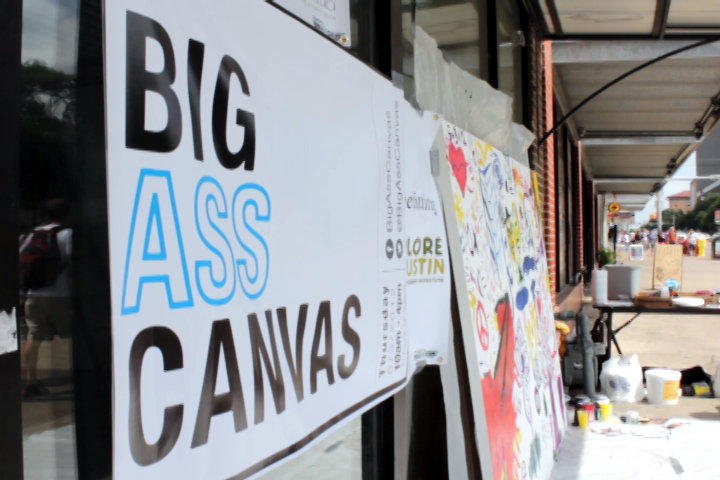 "A project asked random Austinites to paint on a ""Big Ass Canvas"" today, with the results to be auctioned off for charity."