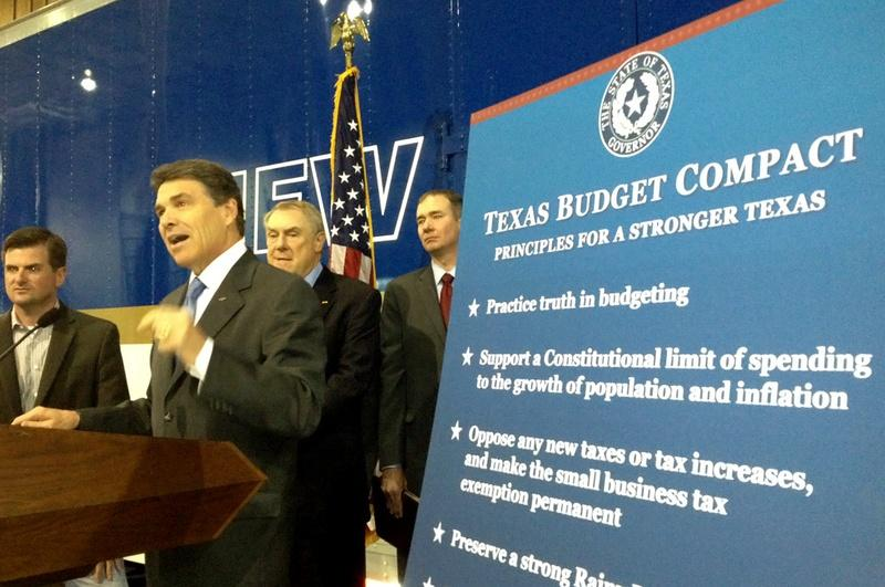 "Gov. Rick Perry unveils his ""Texas Budget Compact"" in Houston on Monday, April 16. On stage with Perry, from left to right: state Reps. Brandon Creighton, R-Conroe, and Wayne Smith, R-Baytown, and conservative activist Michael Quinn Sullivan."