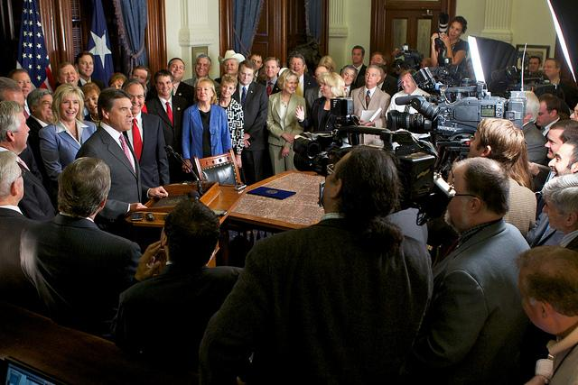 Gov. Rick Perry's ceremonial signing of SB 14, the state's Voter ID law.