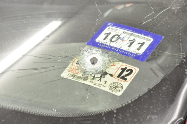 A bullet hole in the car in which Byron Carter, Jr. was found dead after being shot by APD Officer Nathan Wagner on May 30, 2011.