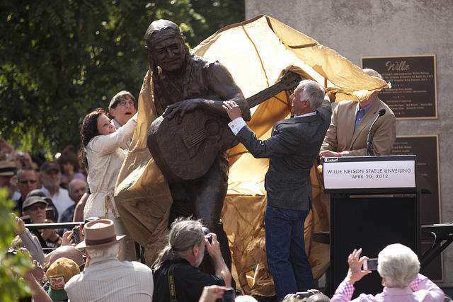 The bronze likeness of Nelson is presented to the public.