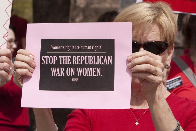 Woman at Texas Capitol protests Republican lawmakers decision to exclude Planned Parenthood from the Women's Health Program.