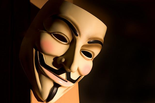 The iconic Guy Fawkes mask associated with Anonymous.