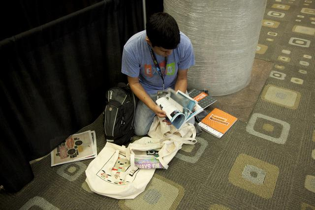 "A SXSW registrant sorts through a ""swag bag."""