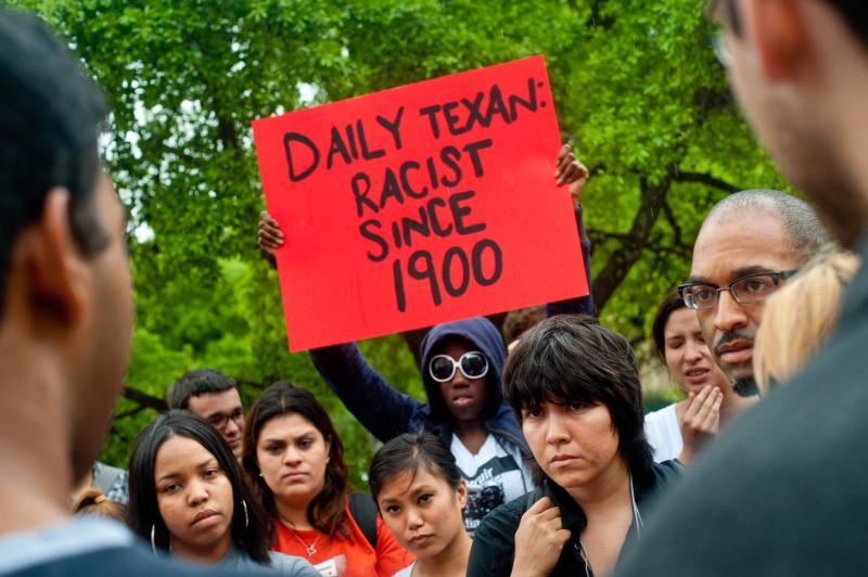 "UT students confront members of The Daily Texan's Editorial Board after an offensive cartoon depicting the media's coverage of Travon Martin's death as ""yellow journalism."""