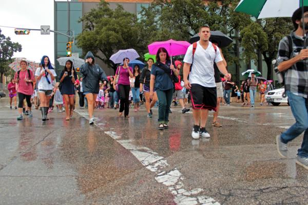 Students leaving campus buildings after the initial evacuation order.