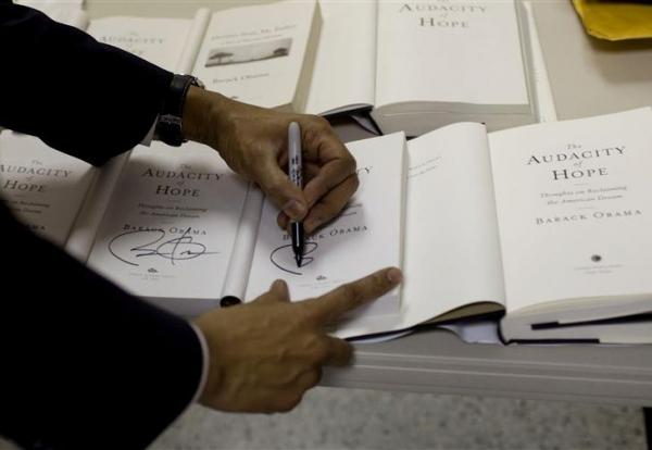 "President Obama signs copies of his autobiography, ""The Audacity of Hope."""