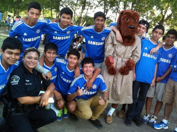 APD Officer Paula Aguilar and her soccer team Chelsea.