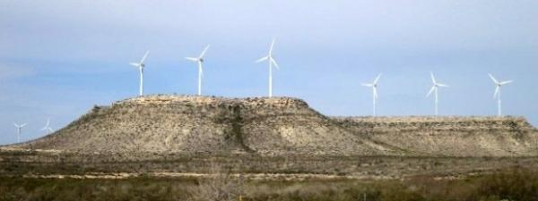 Wind turbines in West Texas create power for population centers in the east.