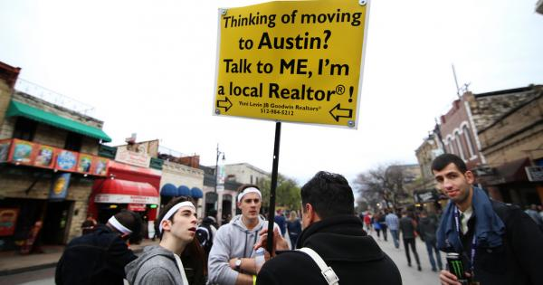Realtor Yoni Levin tries to rustle up some business on Sixth Street during South by Southwest 2014. In new census data, Austin ranks among the fastest growing metro areas in the U.S.