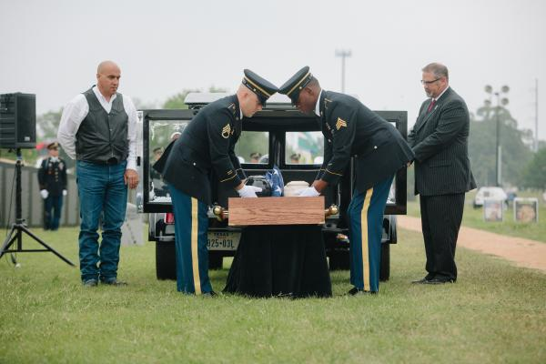 Members of the military ceremoniously handled the twelve urns during the service.