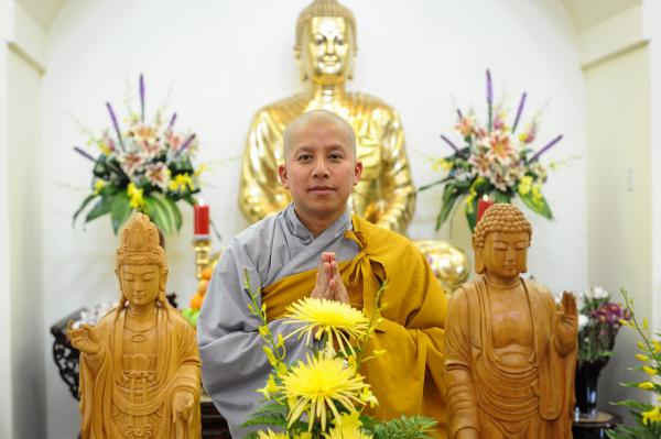 A monk poses for a portrait at the Chua Linh-Son Buddhist Temple. The temple serves a Vietnamese population in North Austin.