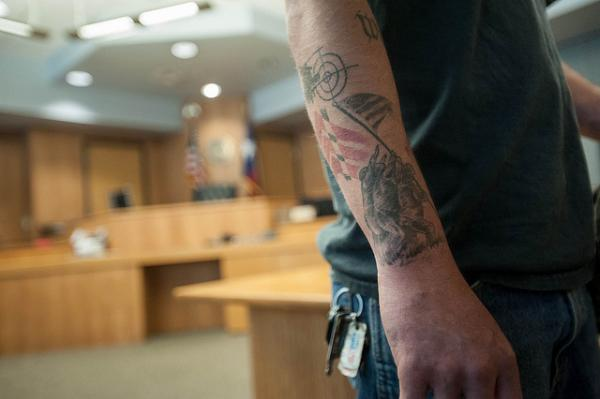 Donny Hilliard has a number of tattoos related to his military service. He began the Travis County Veteran's Court Program on May 15, 2014.