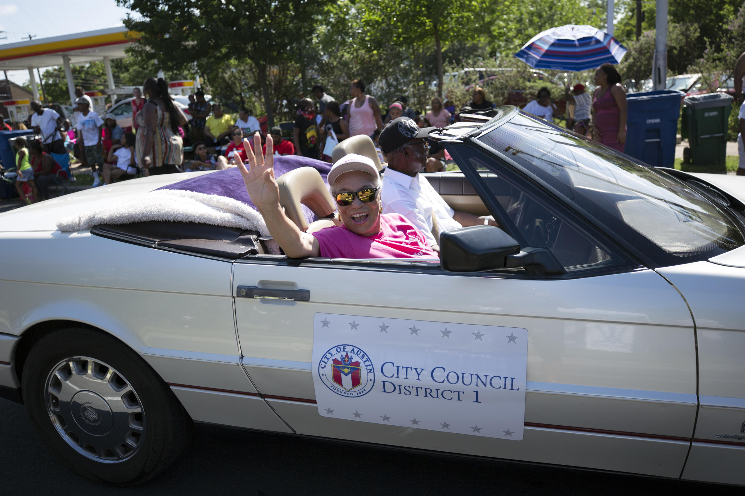 District 1 City Council Member Ora Houston waves to spectators