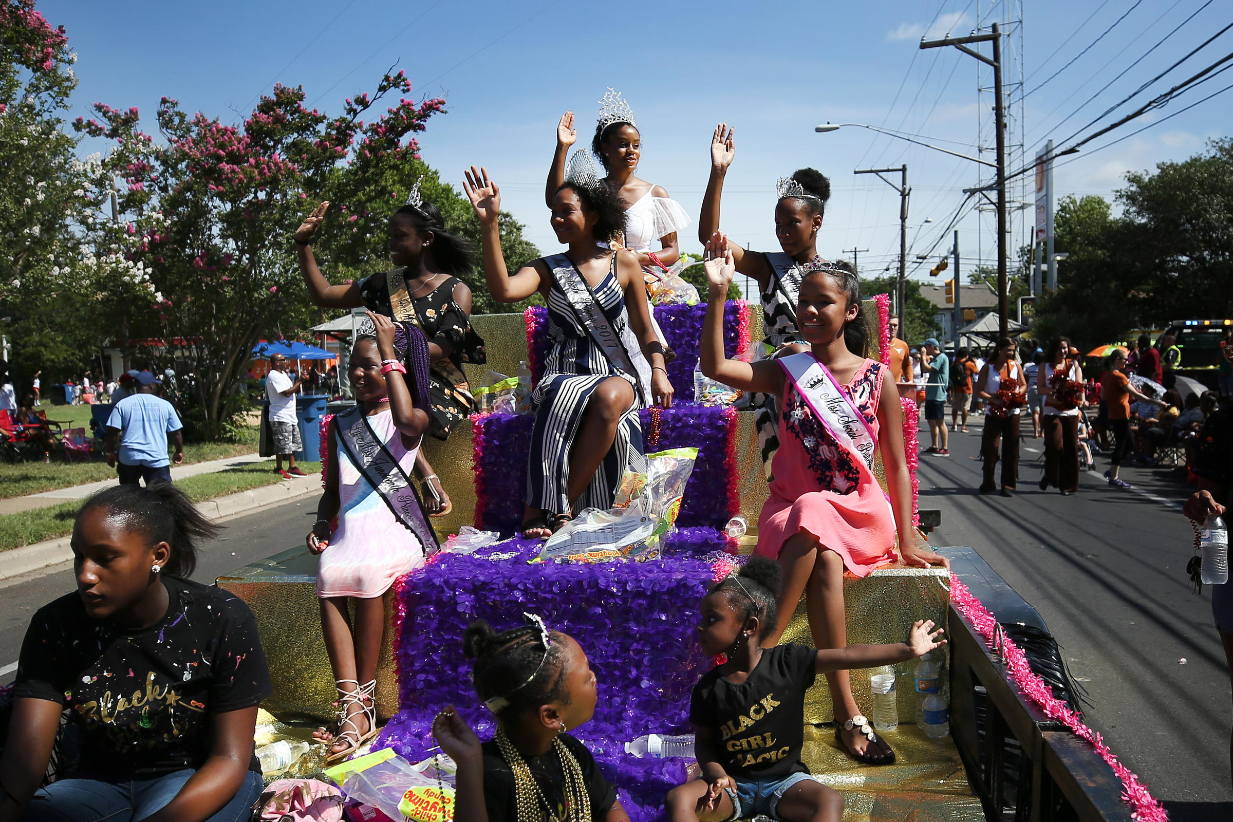 Miss Juneteenth and her court wave to the crowd