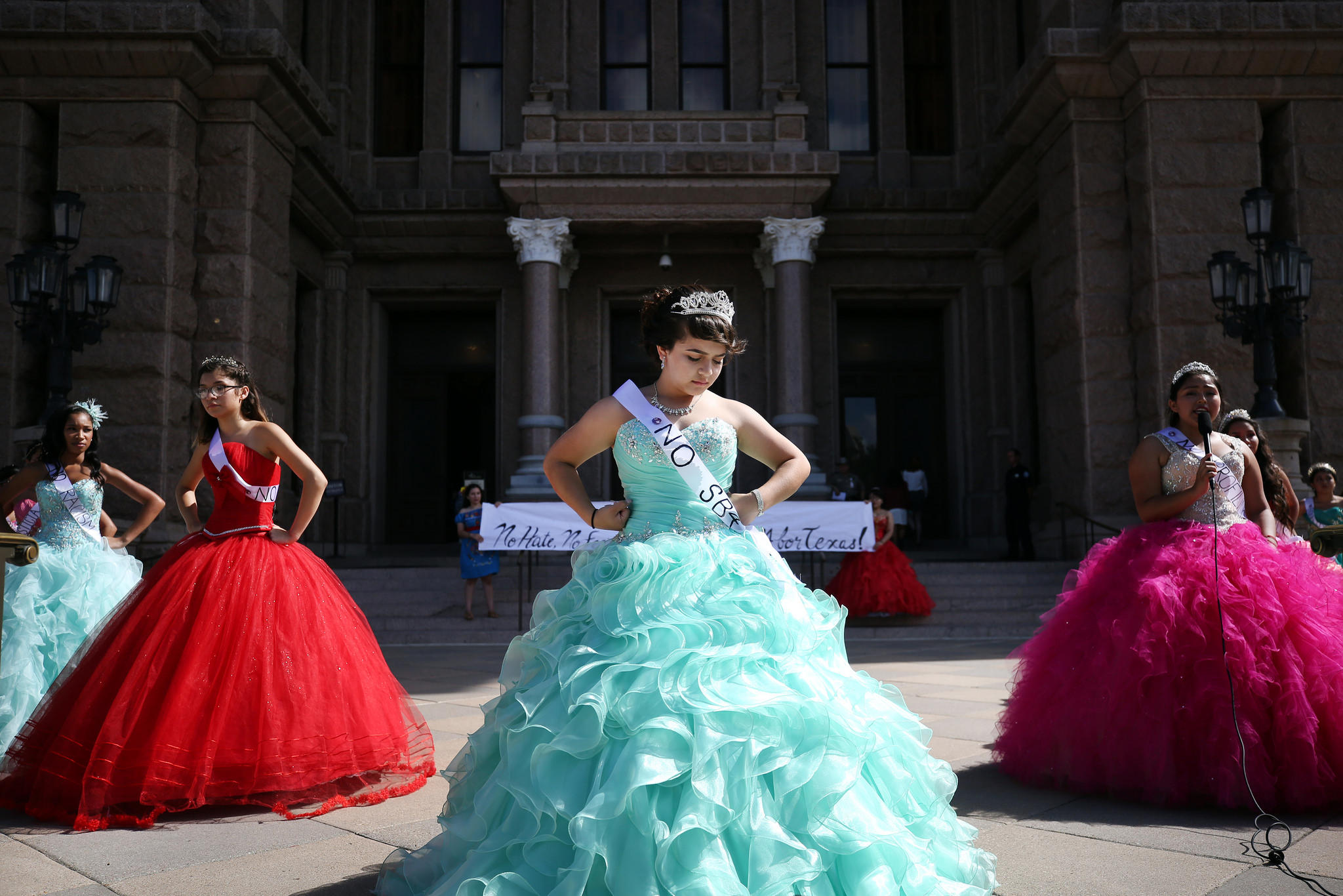 be1ed9da92f Jennifer Ramirez and 14 other young women wearing quinceañera dresses  protest the new sanctuary cities ban on the south steps of the Texas state  Capitol on ...
