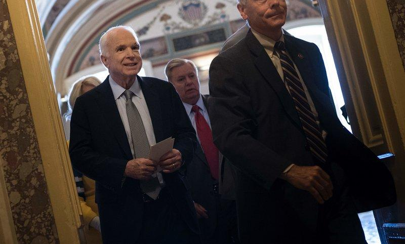 McCain, battling cancer, returns to Senate for critical health care vote