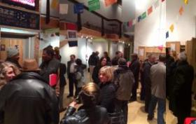 Forum attendees meet and greet at Su Teatro.