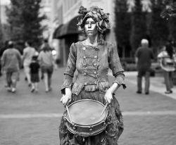 Silver Drummer Girl, a street performer from Asheville, NC