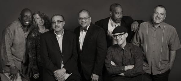 The Weekday Hosts. L-R: Victor Cooper, Susan Gatschet Reese, Carlos Lando, Steve Chavos, Rodney Franks, Erik Troe, and Arturo Gómez