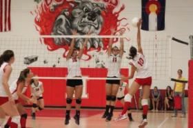 Hotchkiss outside hitter Brielle Palmer goes up for a kill shot against Paonia's Carson Pipher (11) and Abby Campbell. Paonia won the match in three. The two North Fork rivals will play again on Oct. 6.