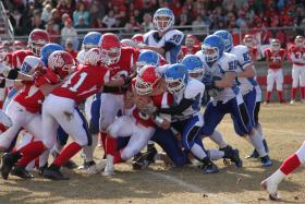 The Cedaredge defense stops Buena Vista QB Koby Close Saturday on their way to the school's first state football title.