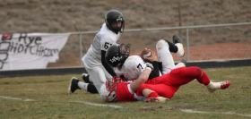 Bulldog Joe Boyle gets the sack in Hotchkiss's 47-26 come-from-behind win over Limon.